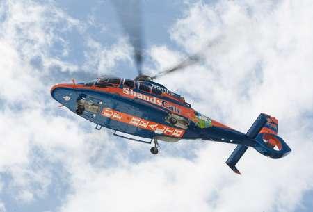 UF Health ShandsCair EC-155 helicopter flying overhead